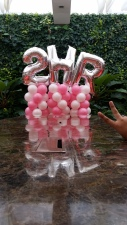 "Spiral balloon columns with 40"" foil balloons on the top"