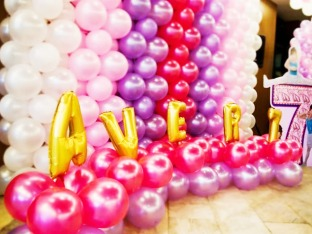 A princess-ish backdrop, combination of metallic purple, pink and fuchsia with foil letters. Girls love it!