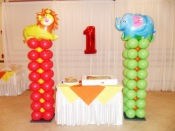 Cute animal themed 1st birthday party balloon columns