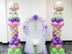 Cute baby columns with pastel coloured balloons