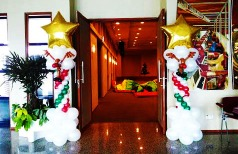 a pair of christmas themed balloon columns