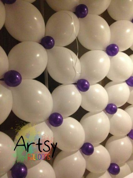 A balloon wall that can be customised to fit any venue.