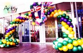 A fully customised masquerade theme balloon arch for a D&D