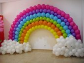 Rainbow balloon arch with clouds