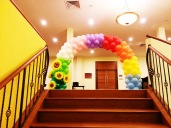 Rainbow balloon arch with additional sunflowers