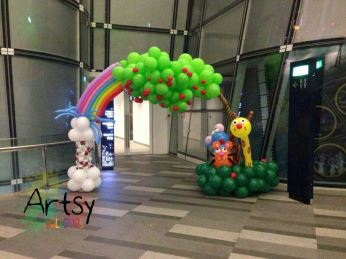 7 rainbow colour balloon arch with animals and fountain