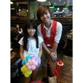 Made a bouquet of flowers of this girl. Took a photo with her because her mum wanted to. HAHA