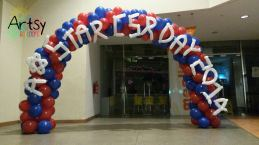 red blue spiral balloon arch + simple balloon alphabets