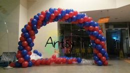 Simple red blue spiral balloon arch