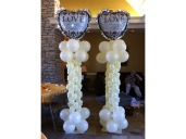 Heart shaped balloon arch with large heart shaped foil on the top
