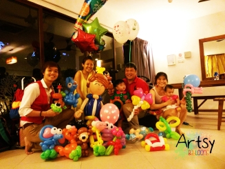 A balloon twisting party at a happy birthday party