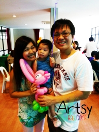 happy family holding a balloon rabbit