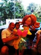 cute girl and happy daddy holding a medium balloon princess