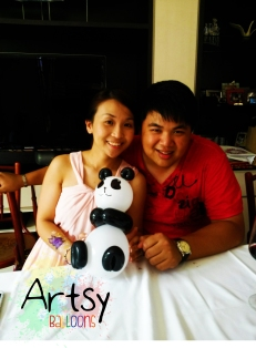happy couple with a balloon panda