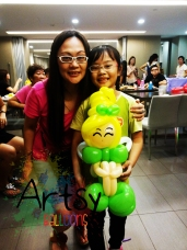 happy girl with a Special Tinkerbell balloon sculpture