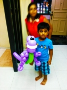 Balloon Sculpting Singapore for birthday parties and events purple dinosaur barney
