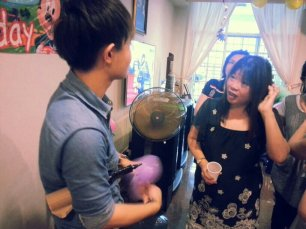 Ouji doing balloon sculpting for a birthday party