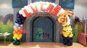 "Minion from despicable me balloon arch with rainbow and ""LUCAS"" box weaved letterings"