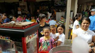 happy children taking candy floss