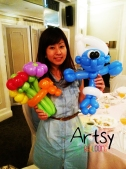 Balloon Sculpting Singapore for birthday parties and events flower and smurfs