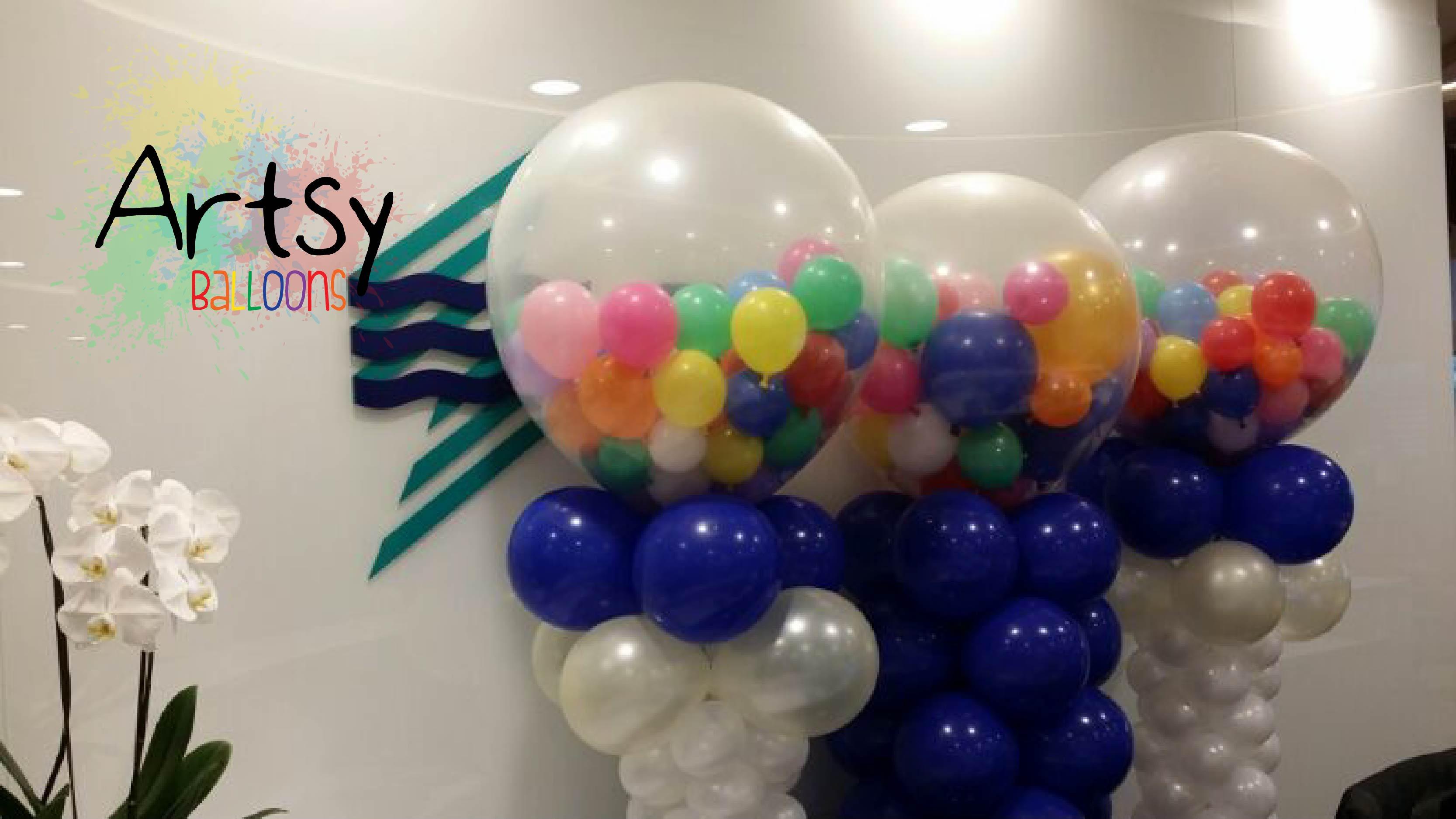 Balloon columns decoration with clear round balloon