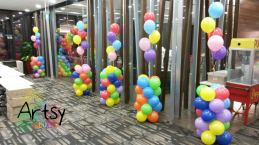 Colourful balloon columns with colourful helium balloons tied to the top