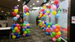 Colourful balloon columns with colourful helium balloons tied to the top(1)