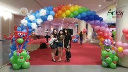 Robot themed rainbow balloon arch