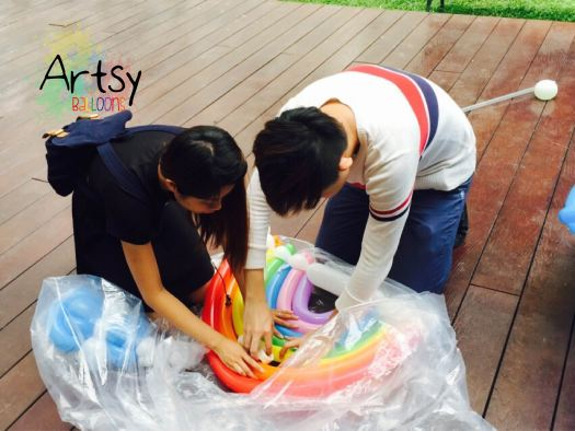 Adjusting the balloon rainbow with glue dots