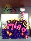 Purple princess themed balloon backdrop with Hello Kitty