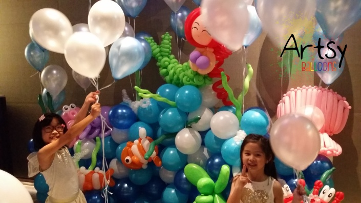 Happy children playing helium balloons