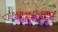 Wedding balloon backdrop with alphabets and direction