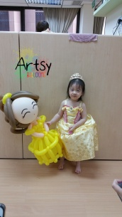 Balloon princess Belle with happy girl