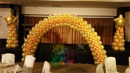 Golden balloon arch for corporate dnd balloon decorations