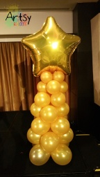 Golden balloon columns with gold foil star