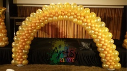 Golden illusion balloon arch