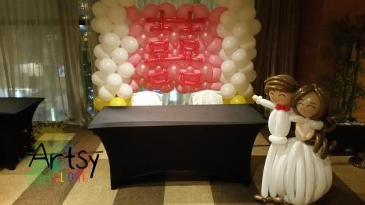 Happiness balloon backdrop with wedding balloon couple