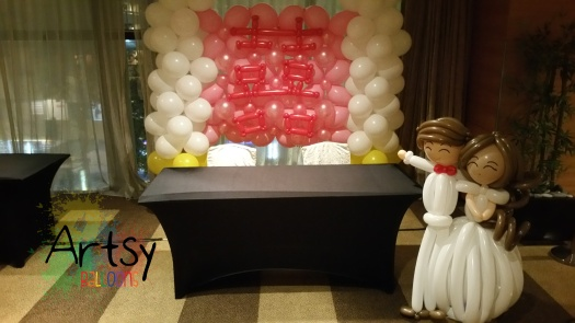 Happiness balloon backdrop with wedding balloon couple