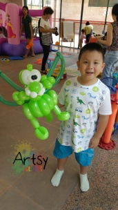 Happy boy with balloon dragon