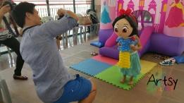 Happy girl with balloon snow white