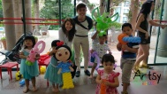 Happy kids with balloon sculptures