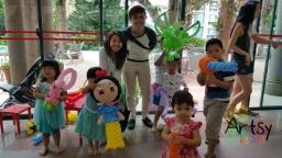 Happy kids with balloon sculptures