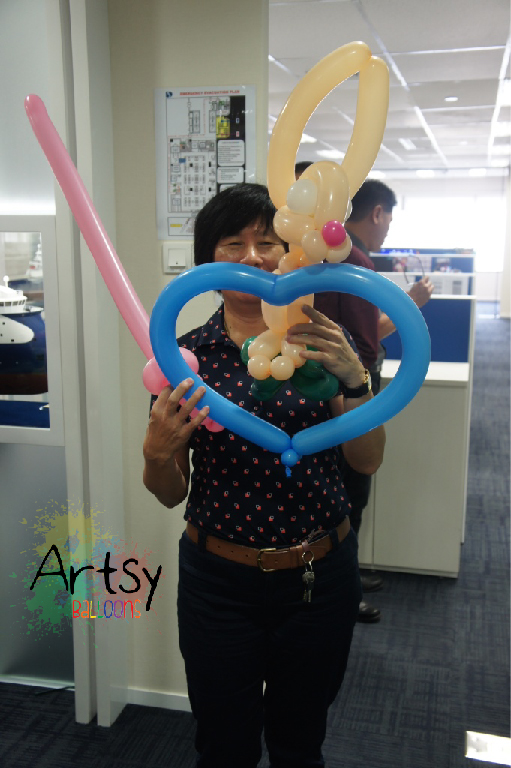 Happy with her balloon sculptures