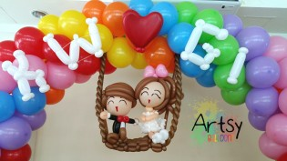 Balloon Sculpting Singapore for birthday parties and events balloon Wedding couple on swing