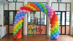 Spiral rainbow balloon arch