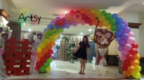 Balloon wedding couple on rainbow balloon arch (2)
