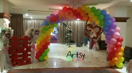 Balloon wedding couple on rainbow balloon arch (3)