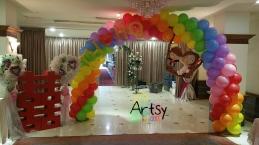 Balloon wedding couple on rainbow balloon arch (3)