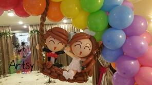 Balloon wedding couple on rainbow balloon arch (4)