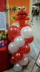 Elmo on balloon columns
